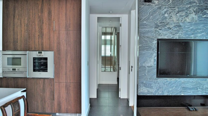 Two bedroom condo for rent in Rajadamri - TV Kitchen